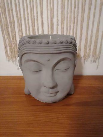 Buda decorativo com vela de citronela