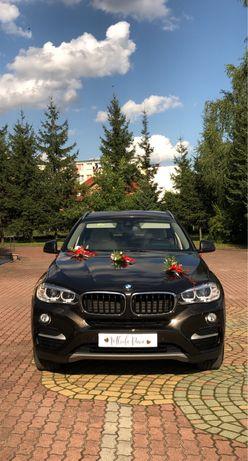 Auto do ślubu wynajem BMW X6 F16 mieniący brąz