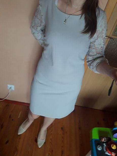 Nowa elegancka sukienka z koronkowymi rękawami 3/4 roz 42.