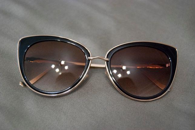 Солнцезащитные очки в металлической оправе золотистого цвета AOFLY