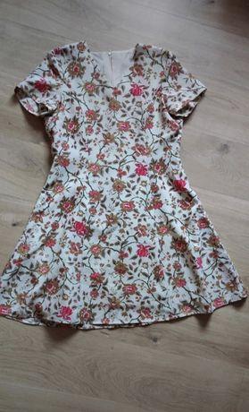 Sukienka w kwiaty r L xl 40 42