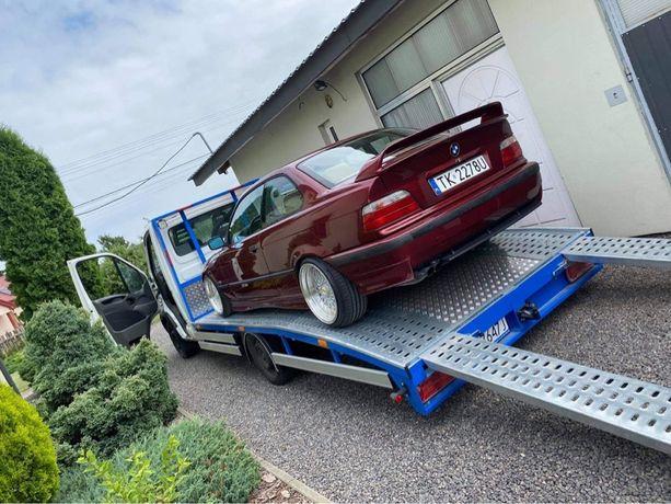 Uslugi autolaweta pomoc drogowa holowanie transport aut materialow