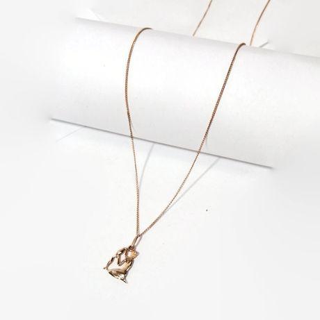Wyrób jubilerski używany - złoty łańcuszek z zawieszką 585/3,92