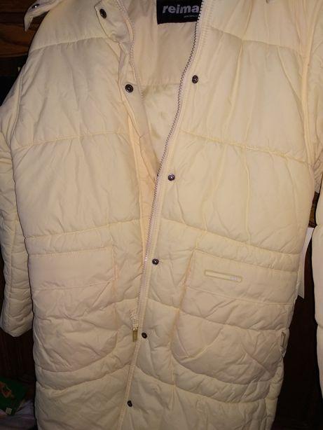 Kurtka zimowa firmy Reima w kolorze intensywnie kremowym rozmiar 150