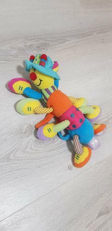 Іграшка на коляску