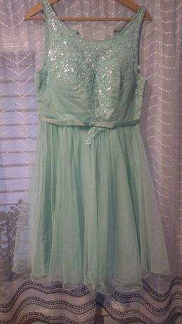 Sukienka miętowa wieczorowa