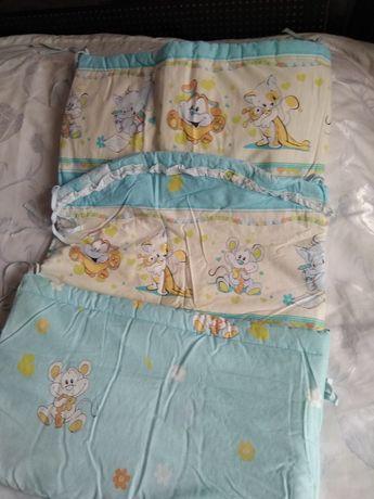 Продам защиту на детскую кроватку