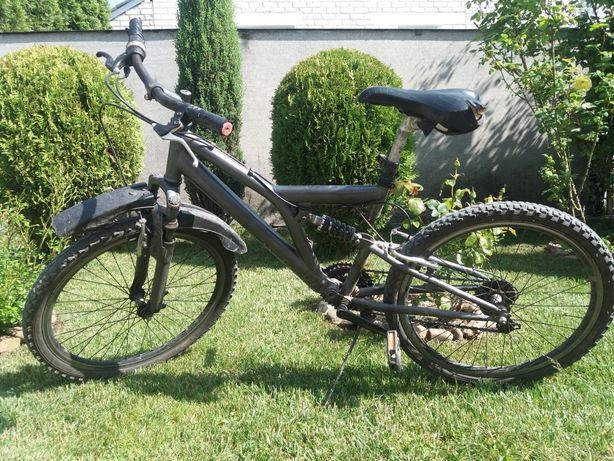 Велосипед горний з робочою вилкою і основним амартизатором