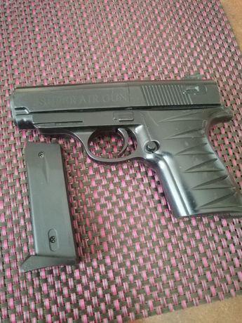 Пистолет для мальчика игрушка