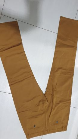 Spodnie r.L/ 40 ciemny musztardowe kolor.Jeans