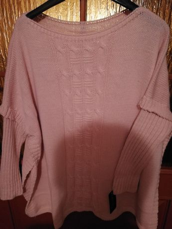 Nowy śliczny sweterek