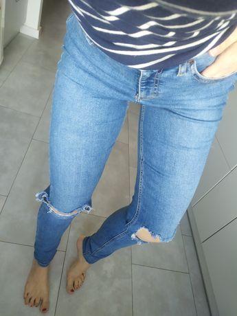 Spodnie rurki jeansy z dziurami topshop m
