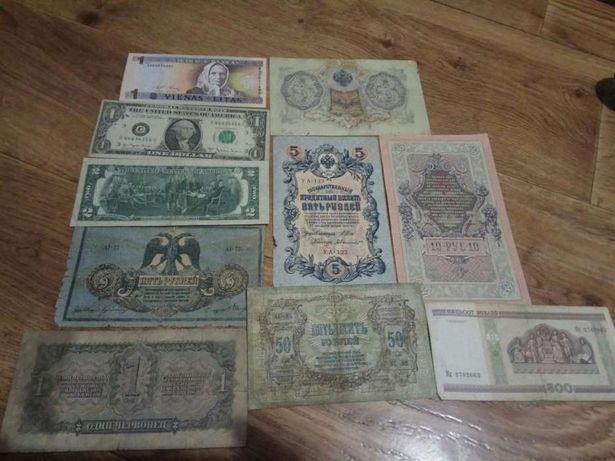 Деньги. Коллекция денежных знаков разных стран.