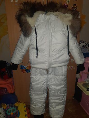 Продам зимний комбинезон возраст 5-6 лет