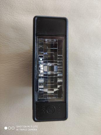 Oslona lampki podświetlenia tablicy rejestracyjnej Nissan