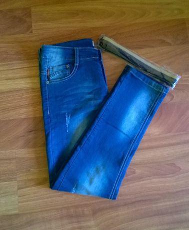 Nowe spodnie dżinsowe. 152.