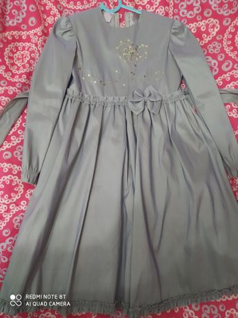 Nowa sukienka w rozm 134