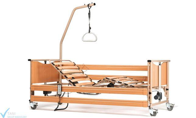 Łóżko rehabilitacyjne dla osoby niepełnosprawnej leżącej