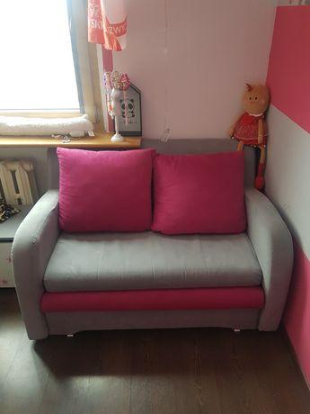 Rozkladana sofa różowo szara