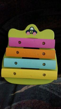 Замечательная деревянная музыкальная игрушка ксилофон Бабочка.