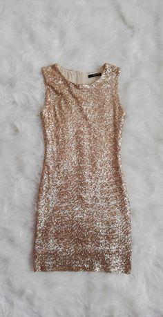 Sukienka złota z cekinami