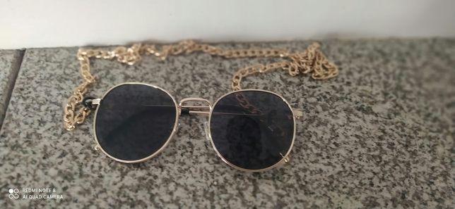 Óculos de sol novos.