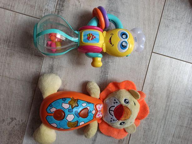Dwie zabawki grające, świecące