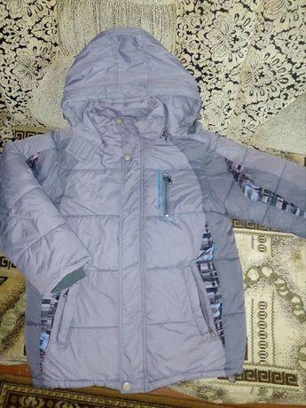 Продам зимнюю куртку на мальчика 9-10 лет.