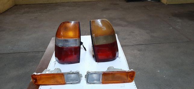 Piscas e farolim Mitsubishi L200
