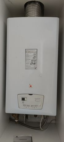 Продам двухконтурный газовый котел б/у Saunier Duval c 25. Дымоход.