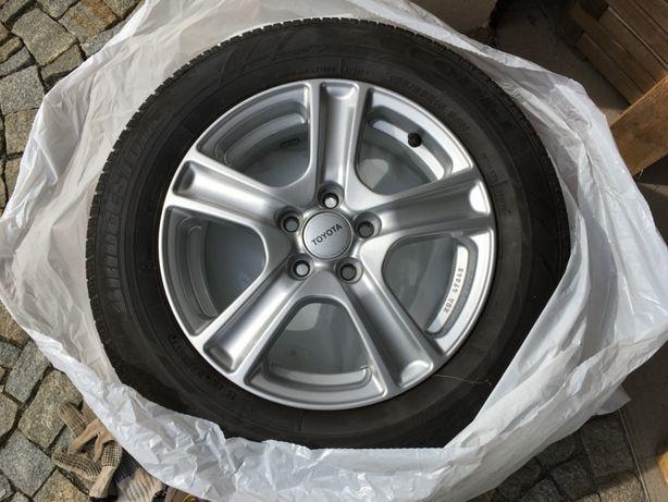 "4 felgi aluminiowe + opony 15"". Toyota"