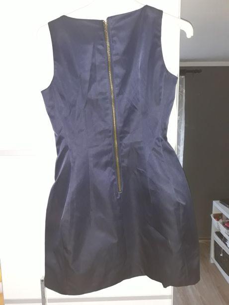Sukienki malo uzywane