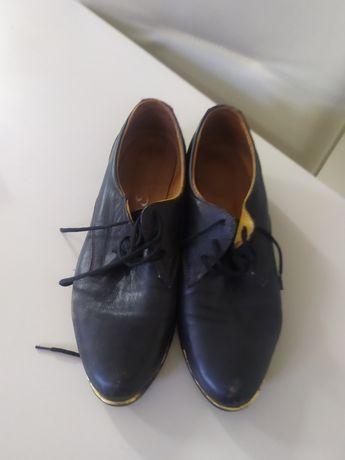 Туфлі шкіряні на шнурівках
