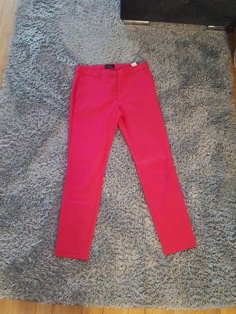 Spodnie Mohito roz 38