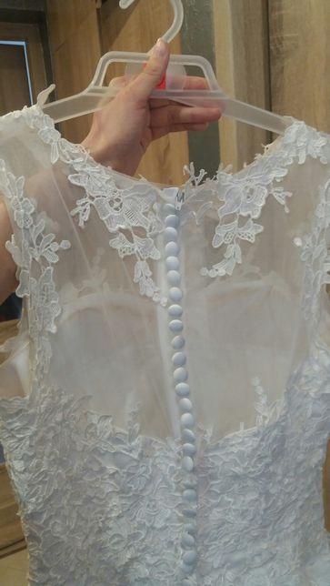 Suknia ślubna M plus koło i pokrowiec.