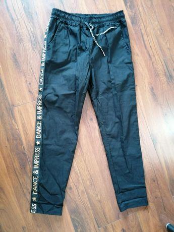 Elastyczne spodnie z lampasem XL