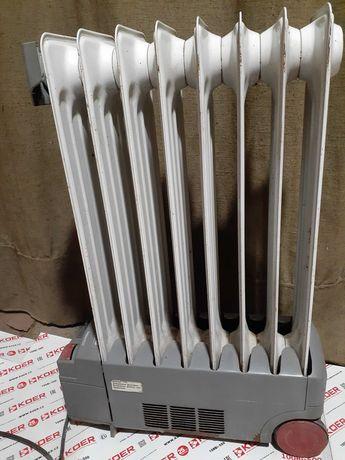 Продам конвектор масляный обогреватель в отличном рабочем Delonghi