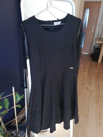 Czarna rozkloszowana sukienka. Cena ostateczna