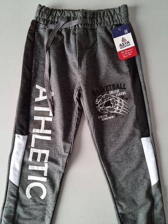 Nowe spodnie dresowe 128