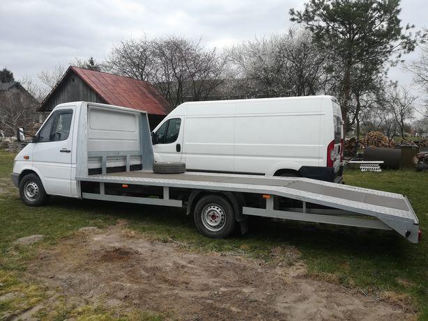 Usługi transportowe autolaweta autoholowanie pomoc drogowa