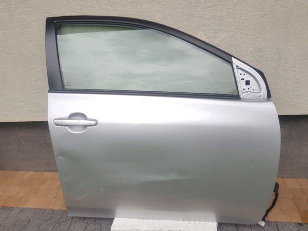 Toyota  Corolla dzwi prawy przód E15