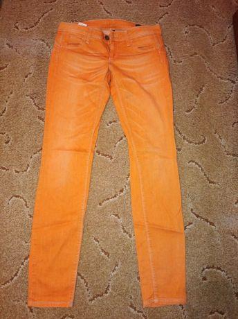 Джинсы оранжевые Benetton