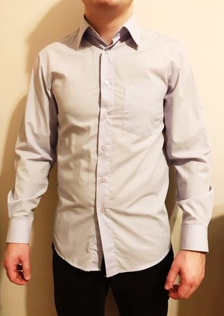 Błękitna koszula elegancka garniturowa