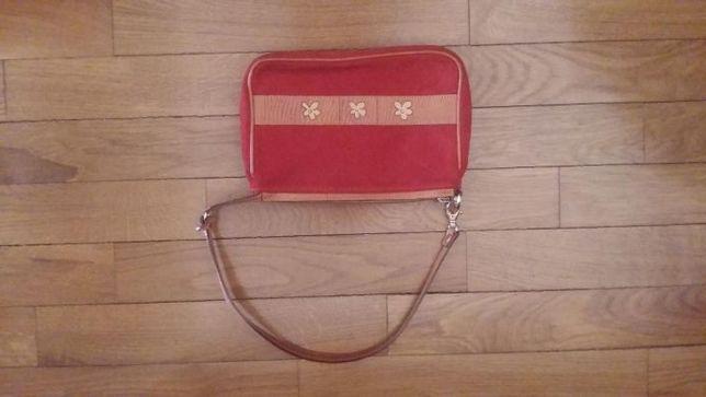 Mochila e Bolsa / mala de mão vermelha e camel em pele