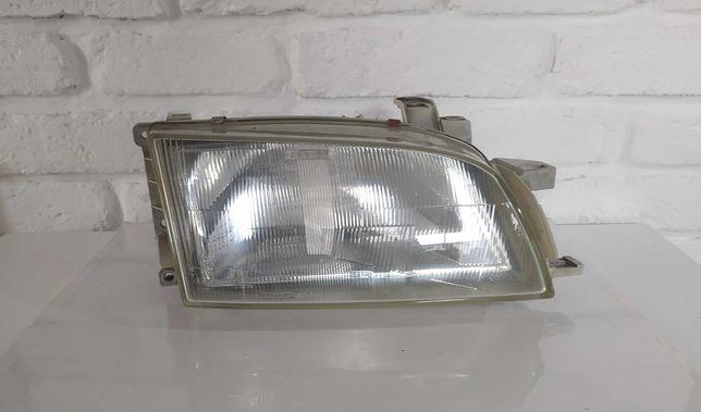 Lampa przednia reflektor Toyota Carina E Prawa 95-97