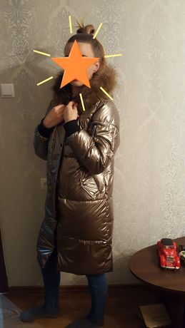 Продам зимний новый пуховик