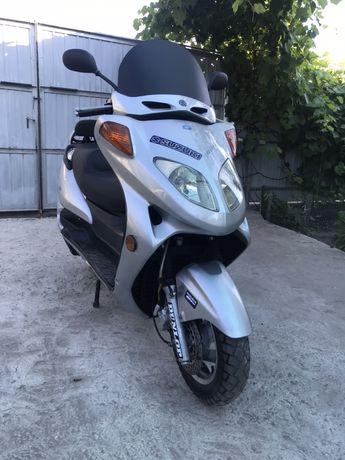 Макси скутер