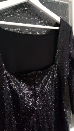 Vestido de lantejolas pretas_com costas decotadas