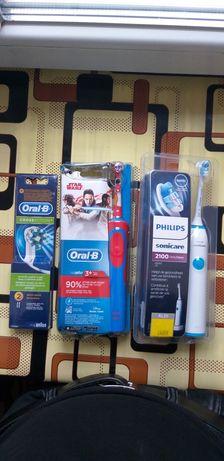 Електрическая Зубная счетка от Philips и Oral-B