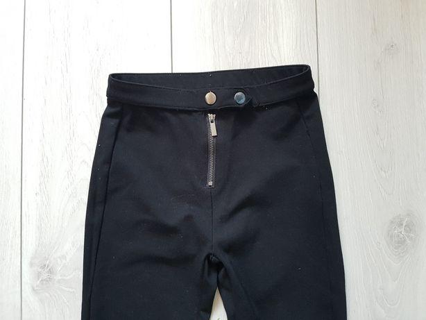 Spodnie Reserved r 134